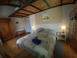 Un ou plusieurs lits dans un hébergement de l'établissement Gites Couvent des Ursulines