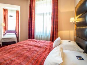 Кровать или кровати в номере EA Hotel Sonata