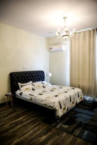 A bed or beds in a room at Sibu Swanhouse No.3