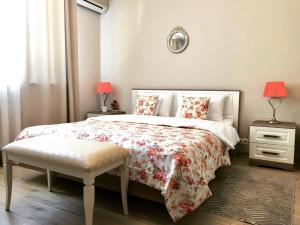 A bed or beds in a room at Boutique Hotel Barvikha House