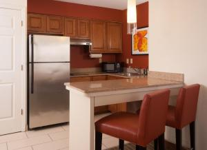 A kitchen or kitchenette at Residence Inn Orlando Convention Center