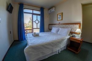 Cama ou camas em um quarto em Via Genova Parque Hotel