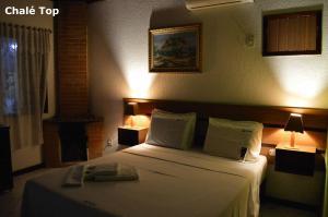 Cama ou camas em um quarto em Pousada Lapônia