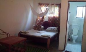 Ein Bett oder Betten in einem Zimmer der Unterkunft Simon House