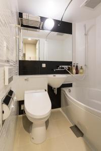 A bathroom at SARASA HOTEL Shin-Osaka