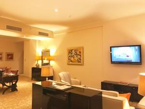 A television and/or entertainment center at Taj HotelApart, Taj Hotel Cape Town