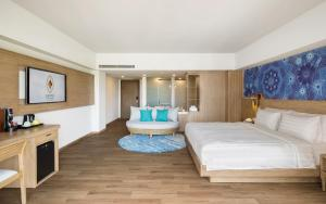 A bed or beds in a room at Eastin Ashta Resort Canggu
