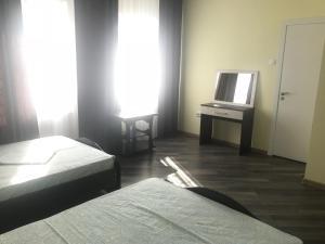Кровать или кровати в номере Мини-отель «Очарование»