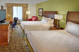A bed or beds in a room at Hilton Garden Inn Danbury