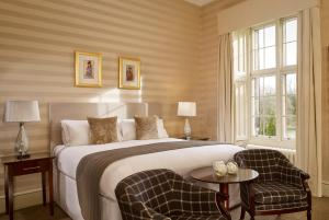 A bed or beds in a room at Mar Hall Golf & Spa Resort