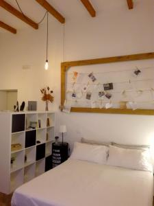 A bed or beds in a room at Casa Vittoria