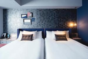 A bed or beds in a room at Mercure Tokyo Ginza