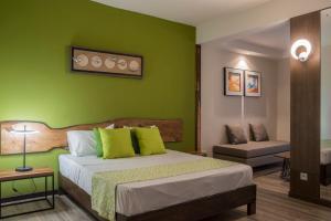 Un ou plusieurs lits dans un hébergement de l'établissement Casa Florida Hotel & Spa