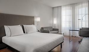 A bed or beds in a room at AC Hotel by Marriott Torino