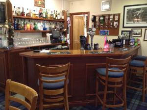 The lounge or bar area at Carnegie Lodge Hotel
