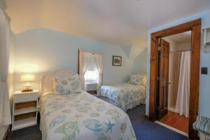 A bed or beds in a room at Pequot Hotel