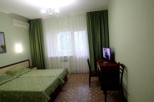 Кровать или кровати в номере Гостевой дом «Санталия»