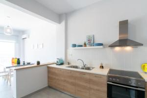 A kitchen or kitchenette at Rodamos apartment