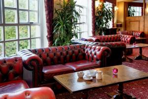 A seating area at Best Western Bury Ramsbottom Old Mill Hotel and Leisure Club