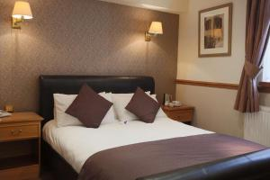 A bed or beds in a room at Best Western Bury Ramsbottom Old Mill Hotel and Leisure Club