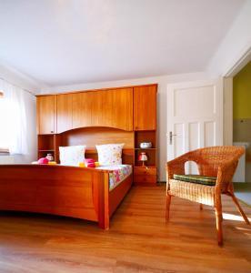 Ein Bett oder Betten in einem Zimmer der Unterkunft Pension Haus Friederike