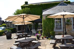 A porch or other outdoor area at The White Hart Country Inn