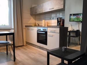 Küche/Küchenzeile in der Unterkunft HertenFlats - Rooms & Apartments - Kreis Recklinghausen