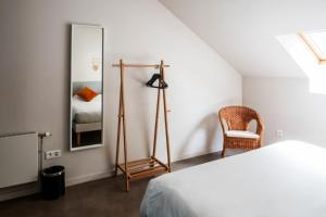 A bed or beds in a room at Gastama - The People Hostel - Green Inn St André