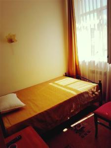 Кровать или кровати в номере Юкка