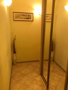 A bathroom at Уютная квартира рядом с МГУ