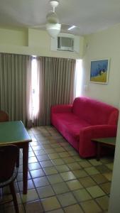 A seating area at Condominio Ondina Residence