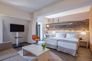 Cama o camas de una habitación en EXE Liberdade