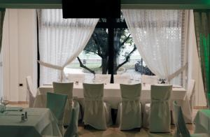 A restaurant or other place to eat at Hotel Molino Rosso
