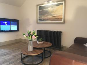 A television and/or entertainment center at Irvine One Bedroom Apartment