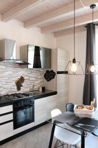 A kitchen or kitchenette at Paradeisos Residence Sas