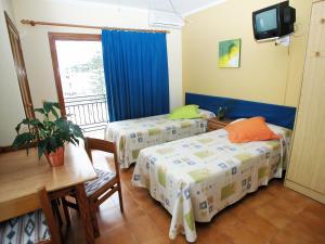 Letto o letti in una camera di Apartamentos Ebusus