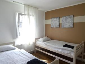 A bed or beds in a room at Hostel 45