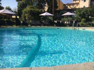 The swimming pool at or near Villa Royal