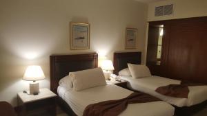 Ένα ή περισσότερα κρεβάτια σε δωμάτιο στο Pyramids Park Resort Cairo
