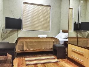 Кровать или кровати в номере Zarya Hotel