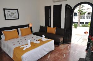 Кровать или кровати в номере Hôtel les Omayades