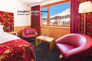 Ein Sitzbereich in der Unterkunft Sport & Wellnesshotel San Gian St. Moritz