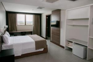 Кровать или кровати в номере WA Hotel Caruaru