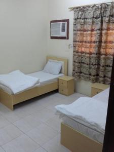 Cama ou camas em um quarto em Istorat Alnaseem