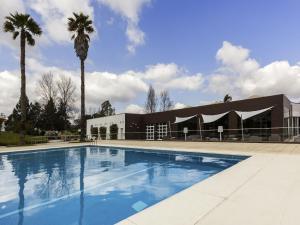 The swimming pool at or near Novotel Setubal