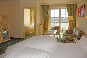 A bed or beds in a room at Alpenhotel Speckbacher Hof