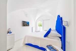 Cama ou camas em um quarto em La Divina Amalfi Coast