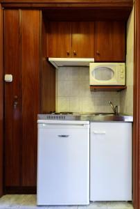 Küche/Küchenzeile in der Unterkunft Aranypatkó Fogadó-Étterem