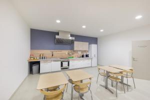 A kitchen or kitchenette at Hotel & Hostel Letov