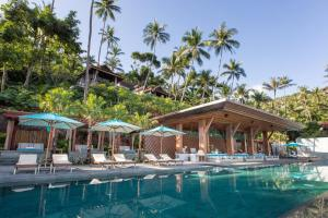 Der Swimmingpool an oder in der Nähe von Four Seasons Resort Koh Samui - SHA Plus
